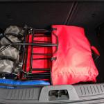 Der Ultrasport zusammengeklappt im Kofferaum eines Kleinwagens
